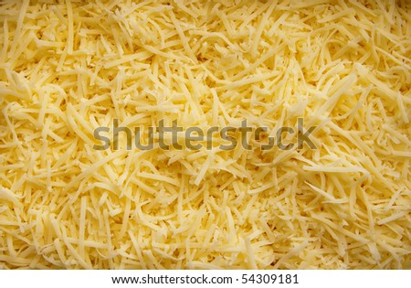 close-up background made of shredded yellow cheese, tasty and fresh - stock photo