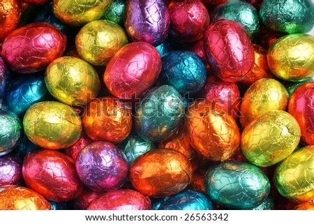 Close-up background of colorful chocolate eggs in foil - stock photo