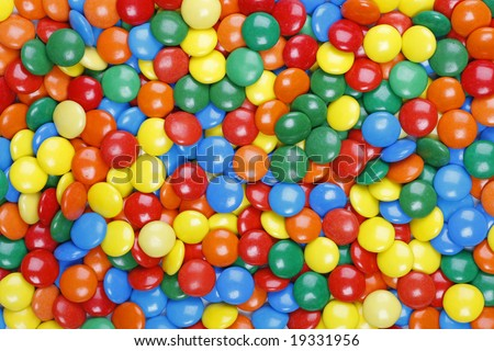 Close-up background of multi colored chocolate candy