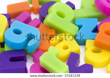 close up background of multicolored magnetic letters - stock photo