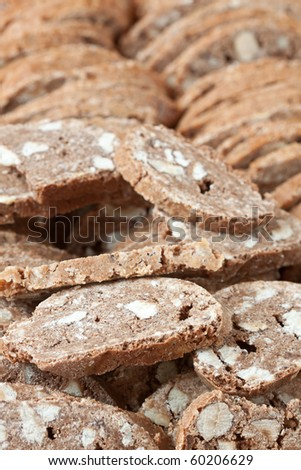 Close-up background of pastry pieces with nuts.