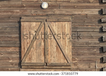 close-up background texture of the walls of a wooden house in natural light