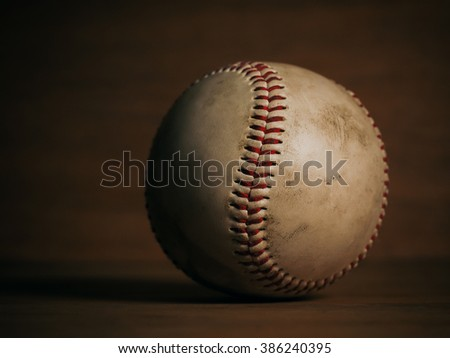close up baseball on wooden background and copy space with focus on one point and shallow depth of field