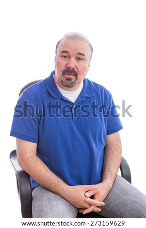 Close up Bearded Middle Age Man, Sitting on a Chair, Looking at the Camera in an Amazed Facial Expression. Isolated on White Background. - stock photo