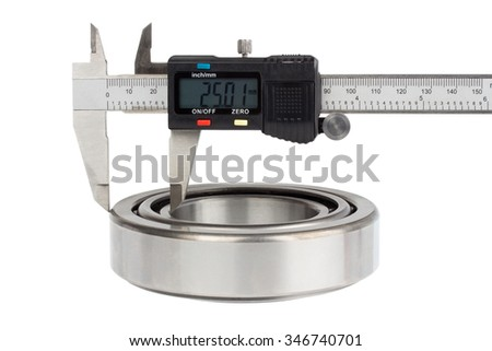 Close up bearing and electronic caliper, on white background - stock photo