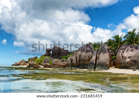 Close up Beautiful Clear Lagoon Water and Big Rocks on the Beach Side, Located at the Island of Seychelles. - stock photo