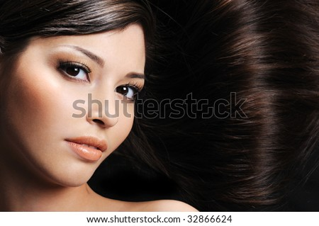 close-up beautiful female face with beautiful healthy long hairs - stock photo