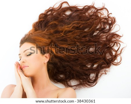 Close-up beautiful fresh young women with red long hair dreaming - stock photo