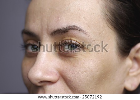close up beautiful green eyes of woman with on left eye - stock photo