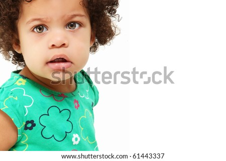Close up beautiful hispanic, african american 1 year old girl up close over white.