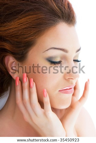 Close-up beautiful luxury fresh bright young red-haired lady in studio shot