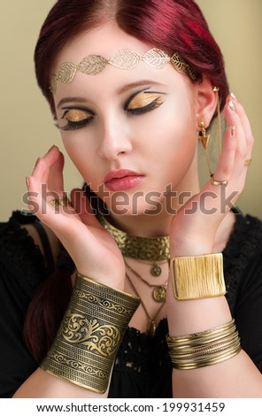 Close up - beautiful makeup girl wearing antique jewels - stock photo