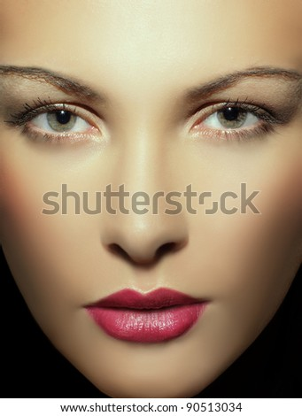 close up beautiful portrait of a young woman - stock photo