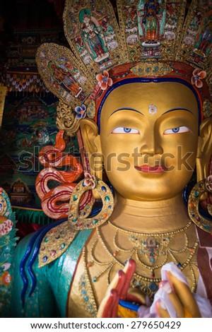 Close up beautiful sculpture of The Maitreya Buddha at Thiksey Monastery in Leh Ladakh. - stock photo