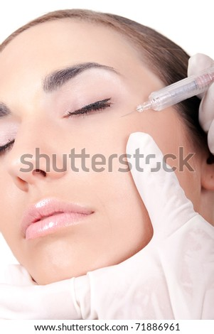 close up-beautiful woman receiving a injection