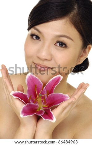 close up beautiful woman with pink lily - stock photo