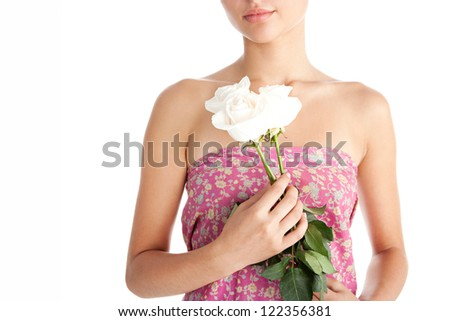 Close up beauty detail view of a young woman hands holding three perfectly shaped white roses, isolated on a white background.
