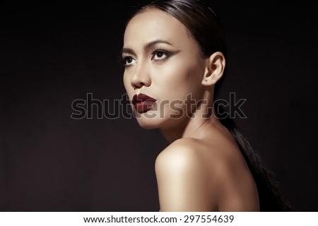 Close up beauty-fashion portrait asian model in dark studio - stock photo