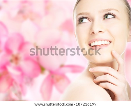 close-up beauty girl portrait on flower background - stock photo