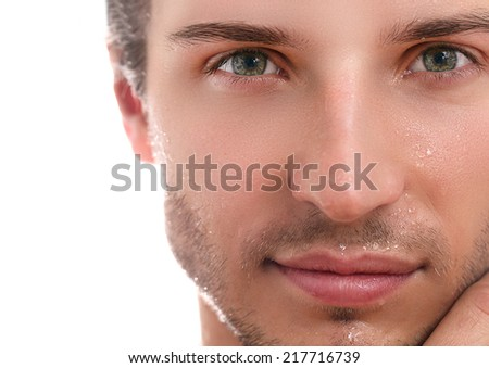 Close-up, beauty. Handsome man on a white background