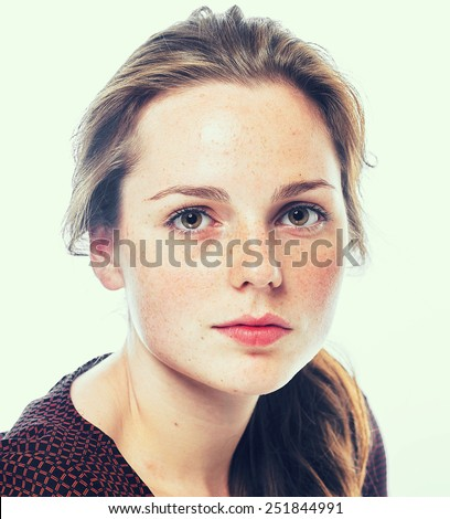 Close-up, beauty portrait of a brunette girl with beautiful lips and freckles - stock photo