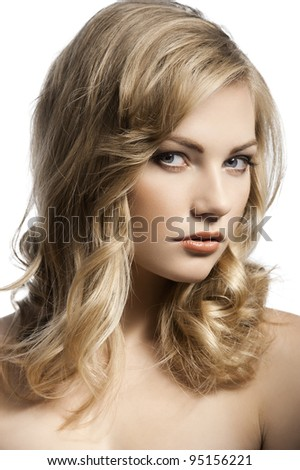 close up beauty portrait of a young and alluring blond girl with hair style over white - stock photo