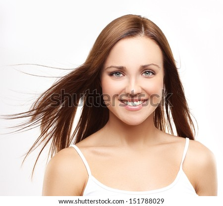 Close-up, beauty portrait of a young brunette woman with beautiful smile. - stock photo