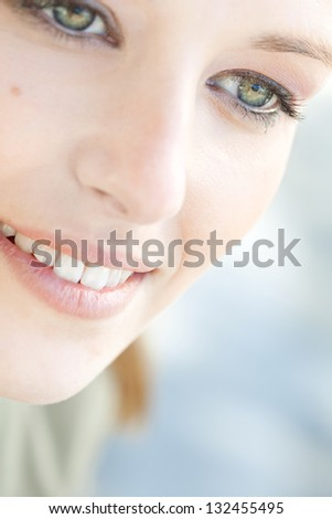 Close up beauty portrait of a young caucasian healthy woman face and eye looking down with long eyelashes. - stock photo