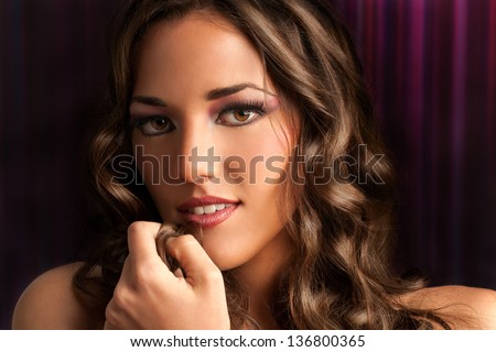 Close up beauty portrait of sensual brunette with curly hair. - stock photo