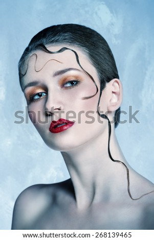 close-up beauty portrait of very pretty blonde woman with stylish make-up, perfect skin and creative decorative hair-style  - stock photo
