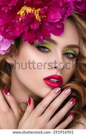 Close-up beauty portrait of young pretty girl with flower wreath in her hair wearing bright pink lipstick, touching her lips. Bright modern summer makeup. Beauty, spa, manicure and skincare concept - stock photo