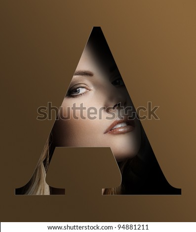 close up beauty portrait of young pretty woman behind a color brown letter A - stock photo