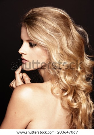 close-up beauty shot of young pretty model with curly blond hair - stock photo