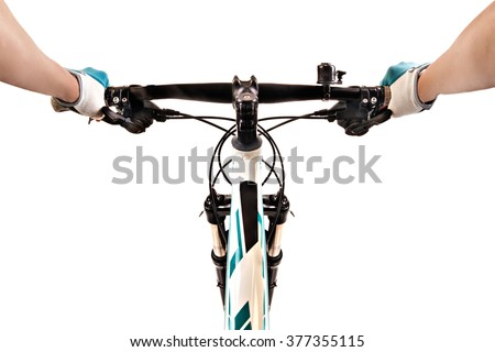 Close up bicycle rider's hands on a mountain bicycle handlebar isolated on white background. Studio shot. - stock photo