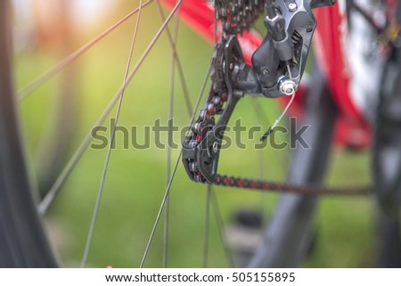 Close-up Bike chain spinning back tire , rear wheel (spinning)