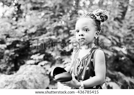 Close up black and white portrait of african baby girl - stock photo