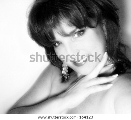 Close up black and white portrait of beautiful older woman smiling - stock photo