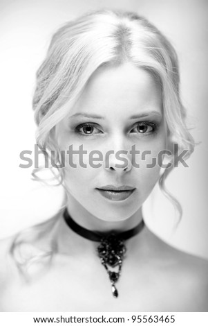 Close-up black and white portrait of young beautiful woman with long blond hair