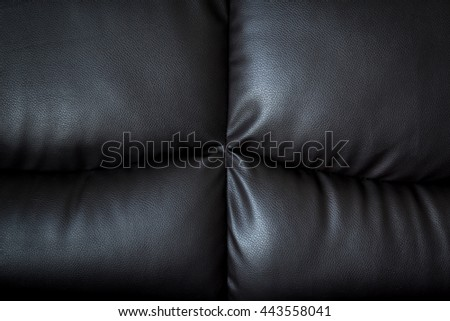 close up black leather sofa and textured and background with space. - stock photo