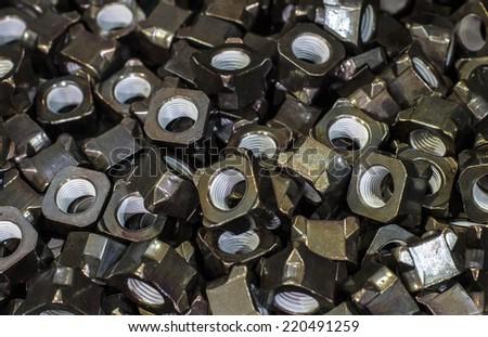 Close-up black metal nut - stock photo