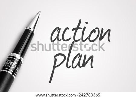 Close up black pen writes action plan on paper - stock photo