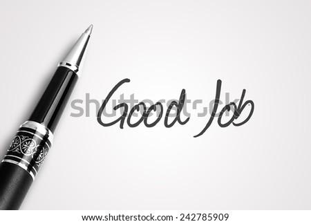 Close up black pen writes good job on paper - stock photo
