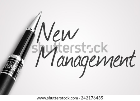 Close up black pen writes new management on paper  - stock photo