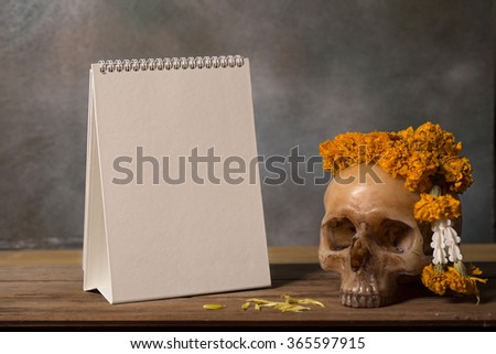Close up blank calendar on vintage wood table for halloween background - stock photo
