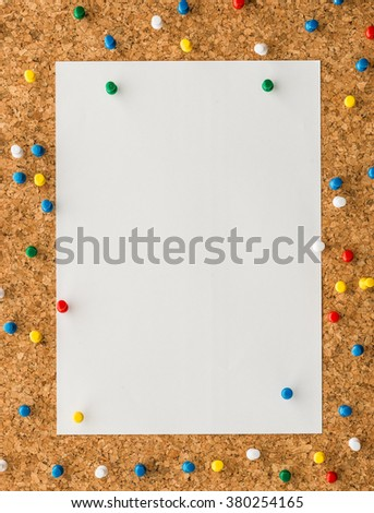 close up Blank white paper note sheet with blue push pin on cork board background for write memo - stock photo