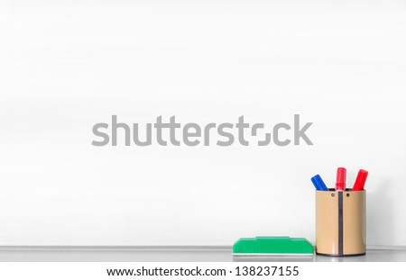 Close up blank whiteboard with blue and red pen in brown round box and green eraser - stock photo