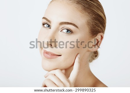 Close up blonde woman face in beauty style against white background - stock photo