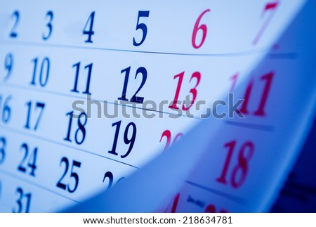 Close up Blue and Red Calendar Numbers Portrait. - stock photo