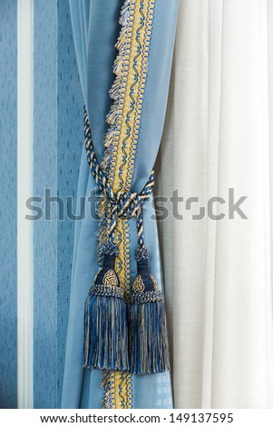 Close up blue color elegance curtain tassel in luxury house - stock photo