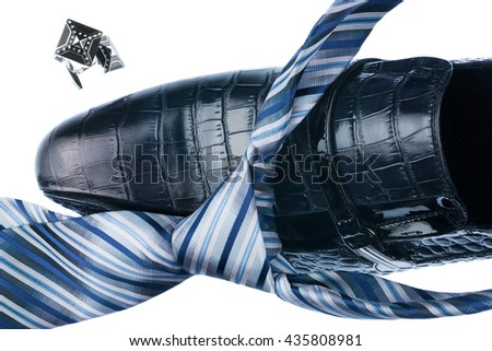 Close-up blue shoes and blue tie, isolated on white background